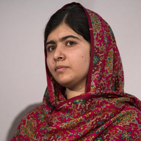 LONDON, ENGLAND - JULY 22:  Pakistani rights activist Malala Yousafzai speaks at the 'Girl Summit 2014' in Walworth Academy on July 22, 2014 in London, England. At the one-day summit the government has announced that parents will face prosecution if they fail to prevent their daughters suffering female genital mutilation (FGM).  (Photo by Oli Scarff/Getty Images)